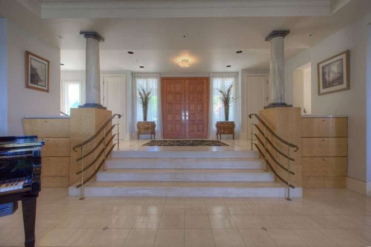 This is the main entrance to the Mediterranean-style home in Federal Way. Outside, it offers a commanding view.