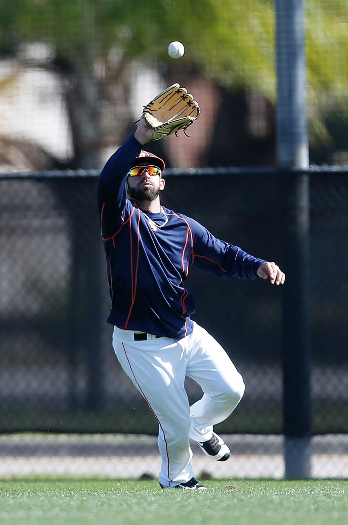 Houston Astros outfielder Andrew Aplin catches a fly ball at the Astros spring training in Kissimmee, Florida, Thursday, Feb. 25, 2016.