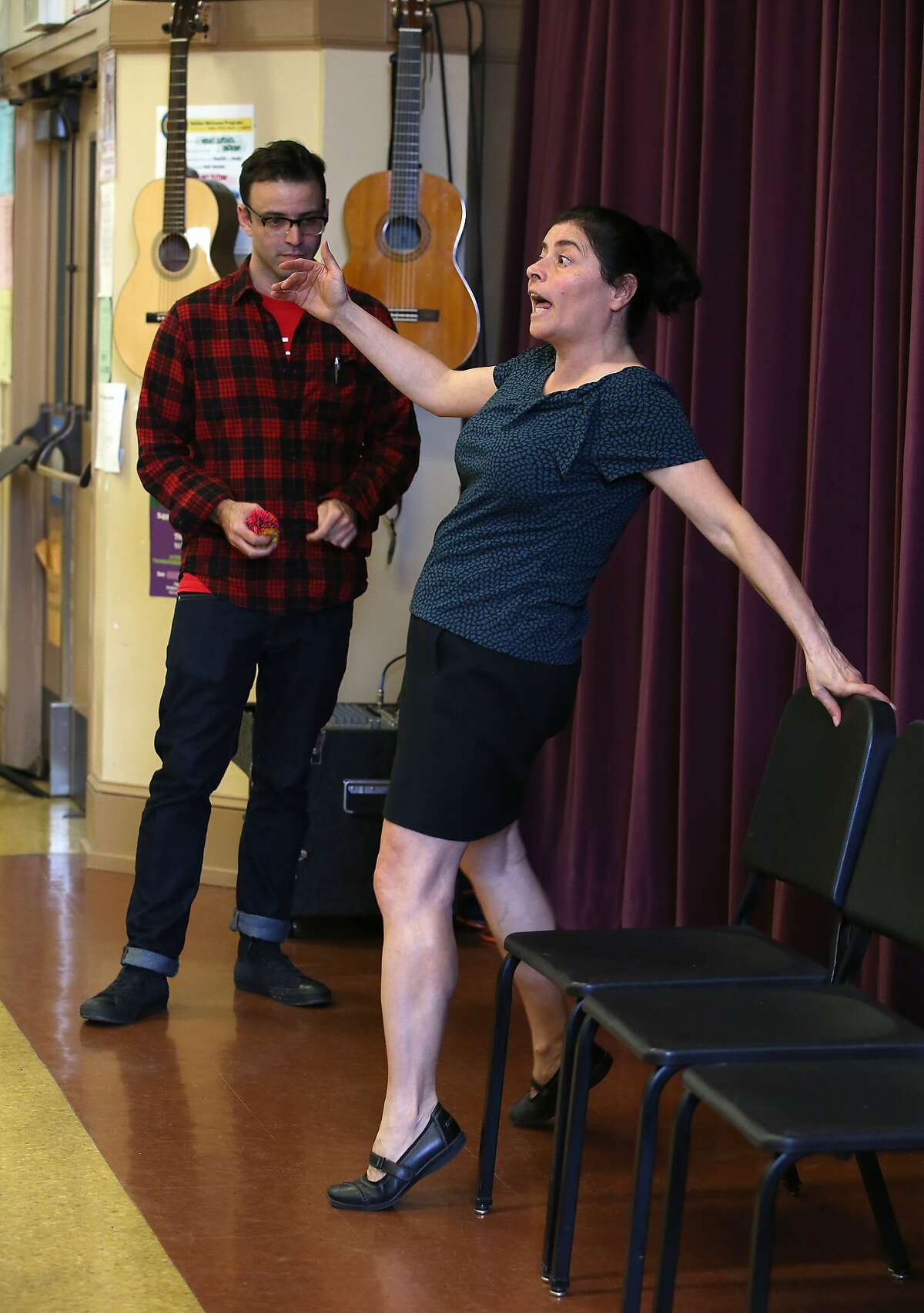 Artist in residence David Jacobs (back left) from A.C.T. and drama teacher Myrna Maroun (right) in the Little Theater at Galileo High School teaching students improvisation in San Francisco, California, on Thursday, February 25, 2016. They will both be co-directors in this semester's play.