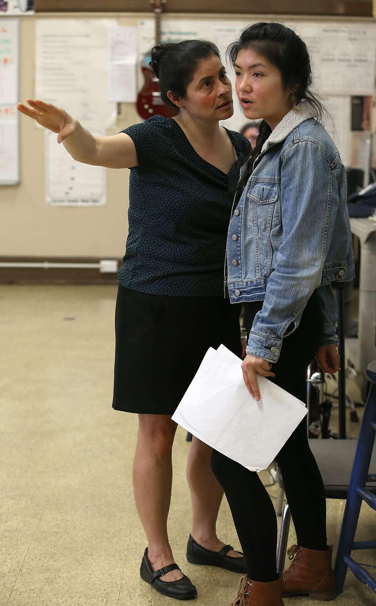 Drama teacher Myrna Maroun (left) talks with senior Michelle Zheng (right), 17 years old, in the Little Theater at Galileo High School while teaching students improvisation in San Francisco, California, on Thursday, February 25, 2016.