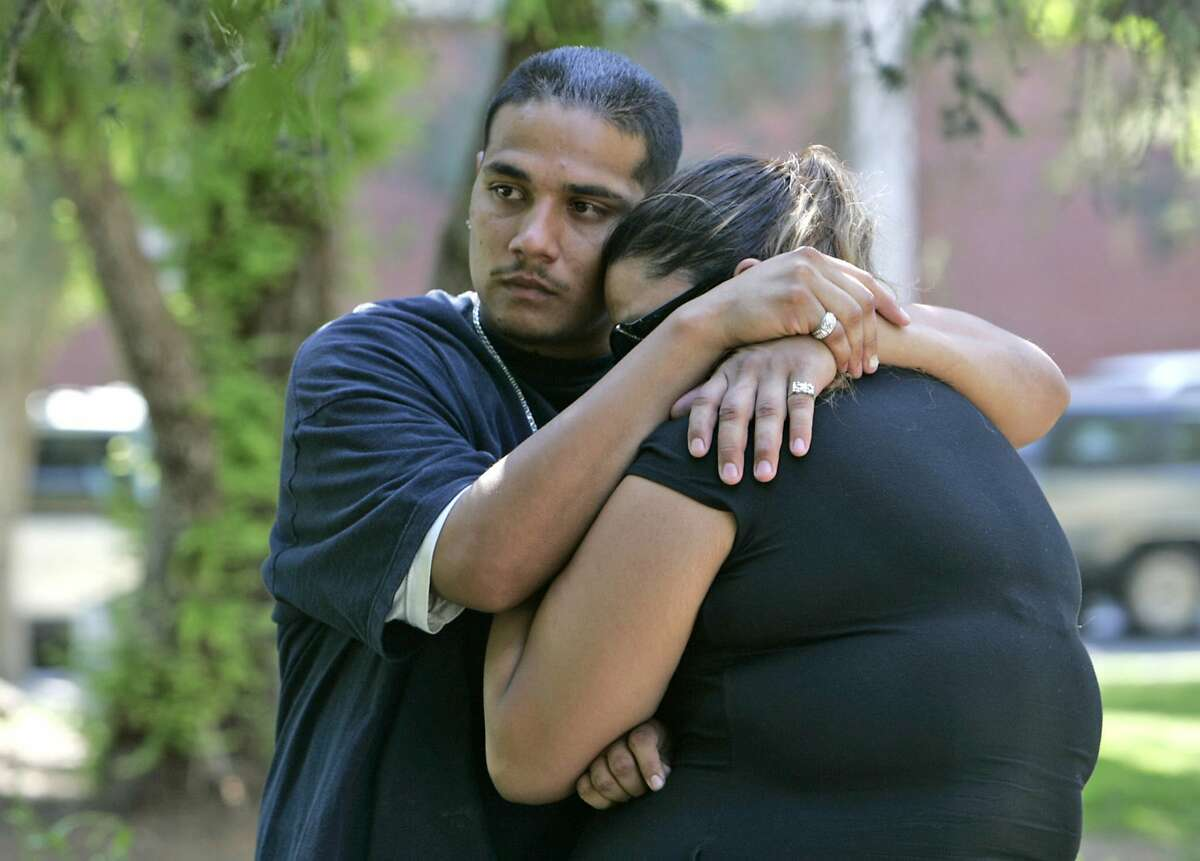 """Hector, left, and Veronica Carrion hug each other outside the courtroom after ex-deputy Ivory John Webb Jr. was found not guilty for shooting their brother, Elio Carrion, in a June 2007 file image. (Karen Tapiaâ€""""Andersen/Los Angeles Times/TNS)"""