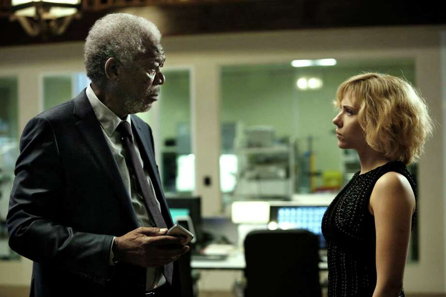 "FILE - This undated photo released by Universal Pictures shows Morgan Freeman, left, and Scarlett Johansson in a scene from ""Lucy."" Movies make more money when exactly half the cast is non-white, according an annual analysis released Thursday, Feb. 25, 2016, that shows an even stronger connection between diversity and profits, and suggests how profoundly out of touch the motion picture academy is when giving Oscars only to white actors. (Jessica Forde/Universal Pictures via AP) ORG XMIT: LA106 Photo: Jessica Forde / Universal Pictures"