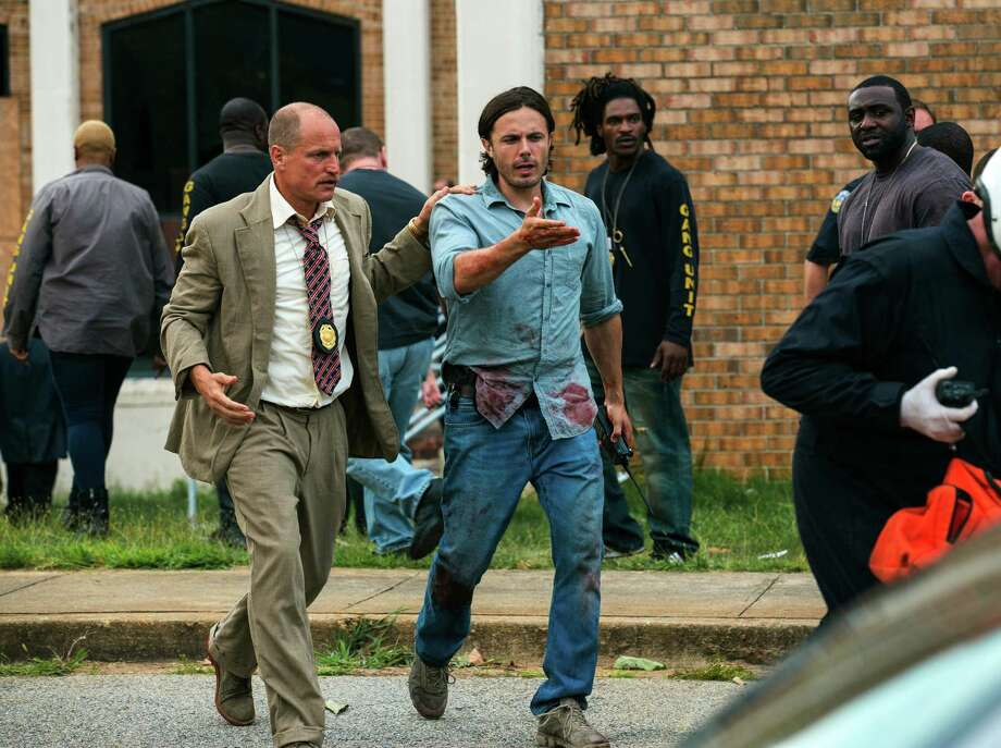 """This image released by Open Road Films shows Woody Harrelson, left, and Casey Affleck in a scene from """"Triple 9."""" (Bob Mahoney/Open Road Films via AP) ORG XMIT: NYET207 Photo: Bob Mahoney / Open Road Films"""