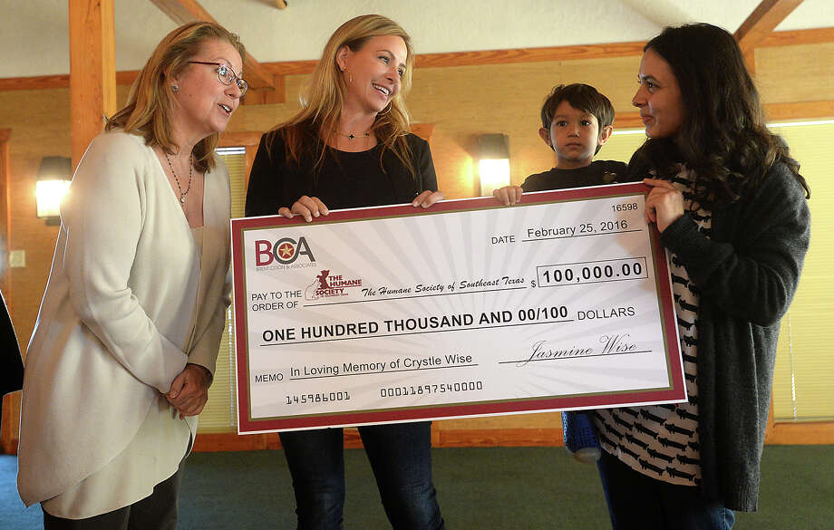 Jasmine Wise jokes with Amy Bean (left), president of the Humane Society of Southeast Texas, and board member Keely Kinsel, after posing Thursday with a check for $100,000 dollars given on behalf of her mother Crystle Wise, who was killed in the DuPont gas leak tragedy in November, 2014. A donation to the local shelter was part of the settlement agreement reached with DuPont following the accident. Wise and her grandmother Betty LeBlanc addressed the gathering, and the family's attorney Brent Coon offered comments, as well. Photo taken Thursday, February 25, 2016 Kim Brent/The Enterprise Photo: Kim Brent / Beaumont Enterprise