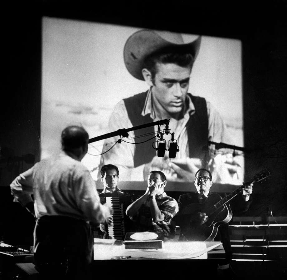"""Photos of the 1956 film """"Giant"""" and late actor James DeanComposer Dimitri Tiomkin (L) directing the muscial score for the last James Dean movie produced 'Giant'. Photo: Allan Grant, Getty Images / Time Life Pictures"""