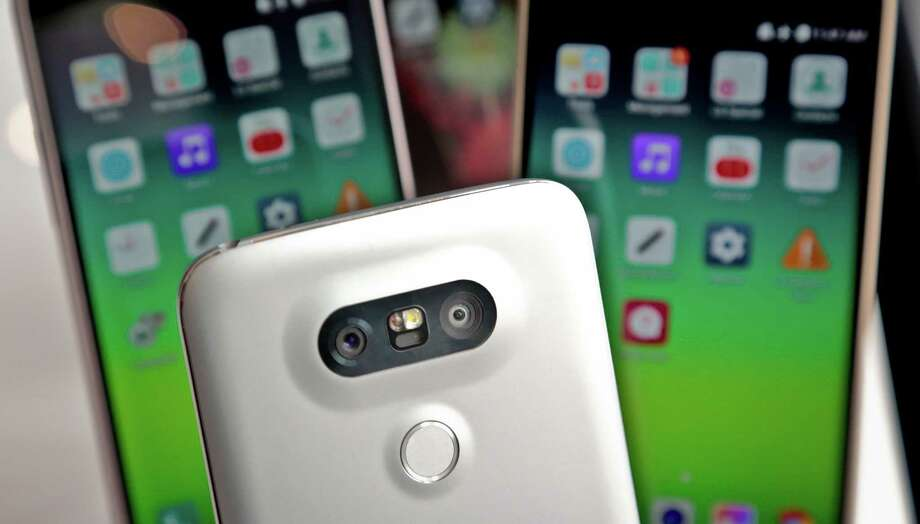 In this Feb. 11, 2016 photo,  the rear camera and front screen of the LG G5 smartphone is displayed in New York. The main camera on the G5 will have two lenses, one for standard shots, and one with a wider angle so you can capture more of what's in front of you without having to step back. (AP Photo/Bebeto Matthews) ORG XMIT: NYR401 Photo: Bebeto Matthews / AP