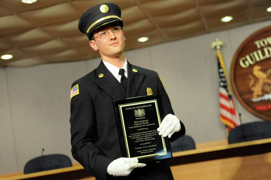North Bethlehem Fire Department First Lt. Cameron Becker receives an award during a ceremony to honor first responders on Thursday, Feb. 25, 2016, at Guilderland Town Hall. Eight first responders whose actions resulted in lives saved during a Jan. 24 fire at 7 Ayre Drive, received special recognition during the ceremony. (Cindy Schultz / Times Union) Photo: Cindy Schultz / Albany Times Union