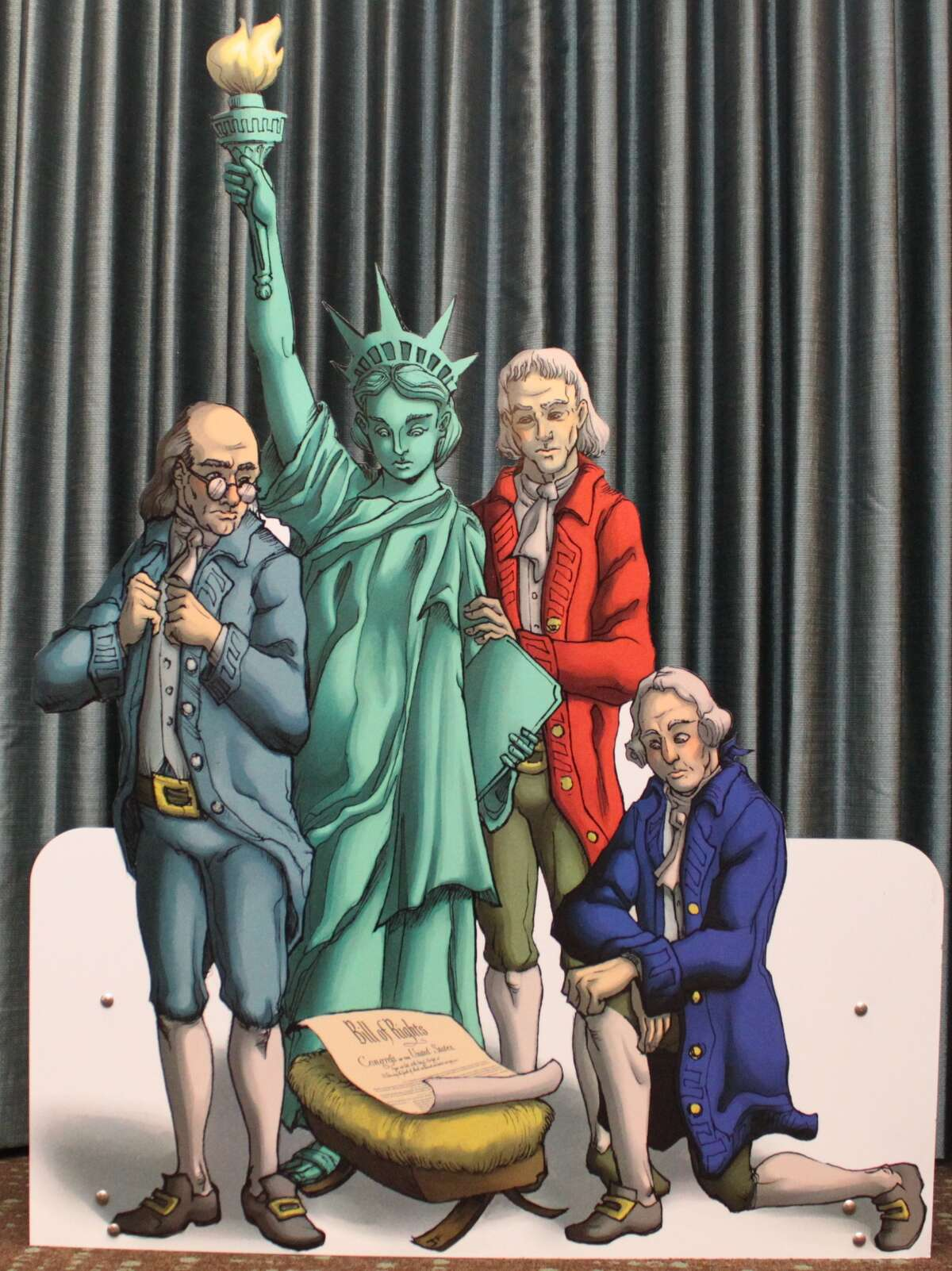 """The Freedom From Religion Foundation, which promotes separation of church and state, claims Abbott illegally censored their exhibit, which depicts """"the Founding Fathers and the Statue of Liberty crowded adoringly around a manger scene containing"""" the U.S. Constitution."""