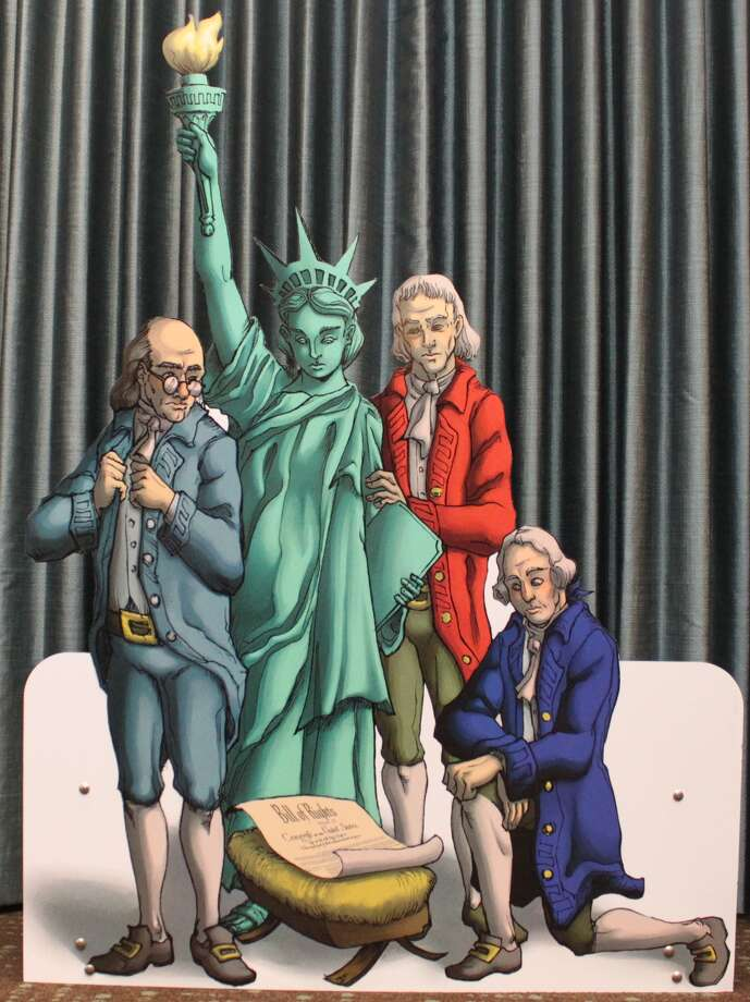 "The Freedom From Religion Foundation, which promotes separation of church and state, claims Abbott illegally censored their exhibit, which depicts ""the Founding Fathers and the Statue of Liberty crowded adoringly around a manger scene containing"" the U.S. Constitution."