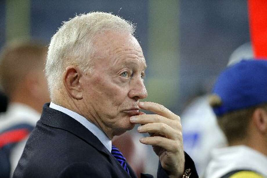 Dallas Cowboys owner Jerry Jones seems nervous as he stands on the sideline during a game against the Seattle Seahawks last year. A reader faults Jones for bringing in players who have run afoul of the law. Photo: Associated Press File Photo