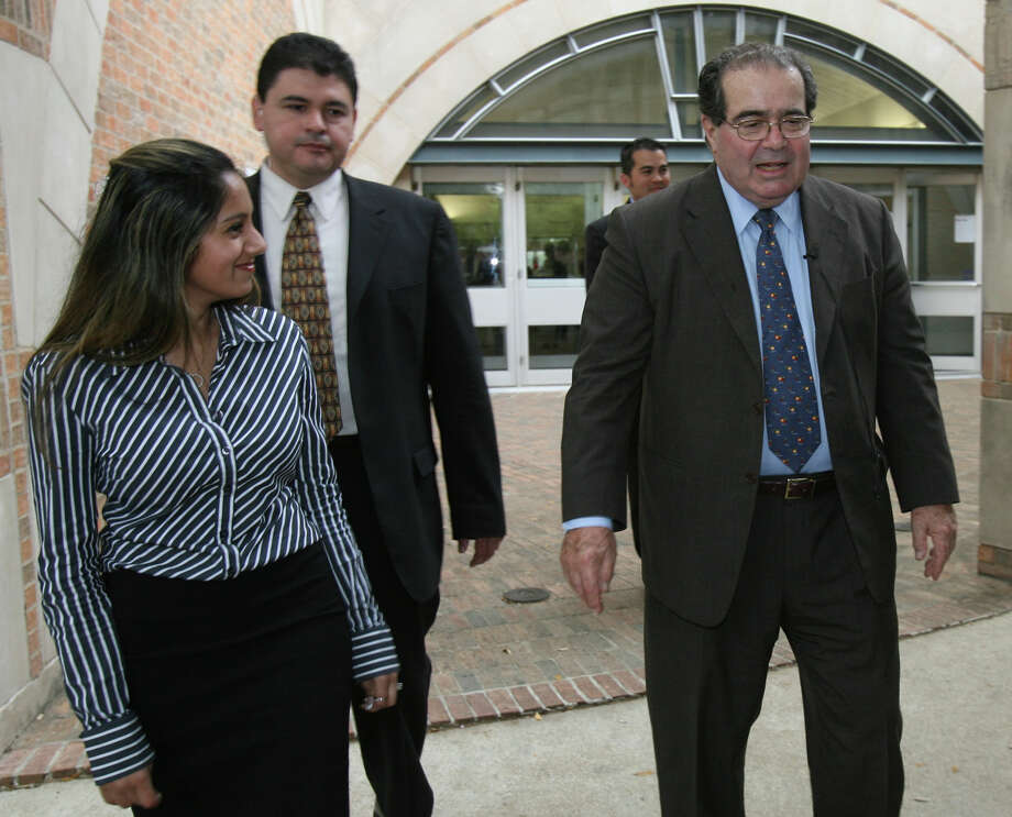 U.S. Supreme Court Associate Justice Antonin Scalia (rt.) leaves a luncheon at St. Mary's University on Thursday April 3, 2008. On the left is first year law student Nishma Shah, who thanked Scalia for speaking to the Constitutional law class that she was a student in. Photo: JOHN DAVENPORT /SAN ANTONIO EXPRESS-NEWS / SAN ANTONIO EXPRESS-NEWS