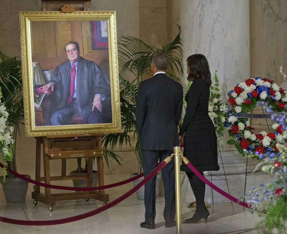 President Barack Obama and first lady Michelle Obama stop to look at a portrait of Supreme Court Justice Antonin Scalia after paying their respects in the Great Hall of the Supreme Court. A reader contends that was not enough. Photo: Pablo Martinez Monsivais / Associated Press / AP