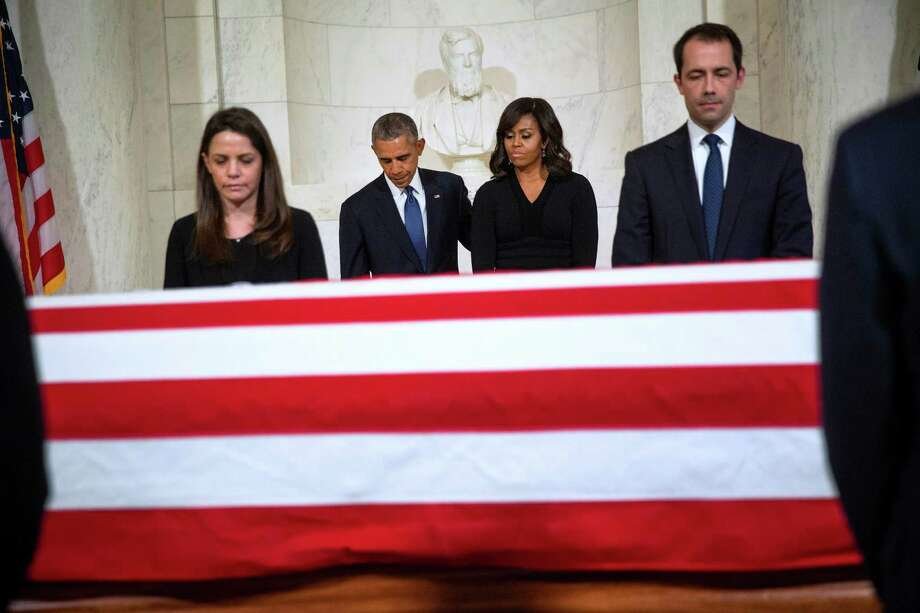 President Barack Obama and first lady Michelle Obama pay their respects as Justice Antonin Scalia laid in repose in the Great Hall of the Supreme Court building in Washington, Feb. 19. Despite claims on the left, the Constitution does not impose any timetable on Senate action on presidential nominations for the Supreme Court. Photo: Doug Mills /New York Times / NYTNS