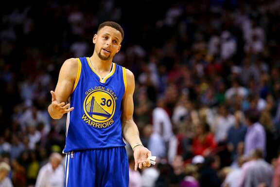MIAMI, FL - FEBRUARY 23: Stephen Curry #30 of the Golden State Warriors reacts during the game against the Miami Heat at the American Airlines Arena on February 24, 2016 in Miami, Florida.  NOTE TO USER: User expressly acknowledges and agrees that, by downloading and or using this photograph, User is consenting to the terms and conditions of the Getty Images License Agreement. (Photo by Rob Foldy/Getty Images)