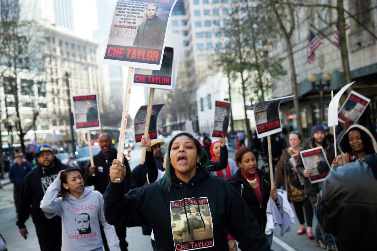 Demonstrators protest the fatal shooting of Che Taylor by Seattle police, on Fourth Avenue in front of Westlake Center.