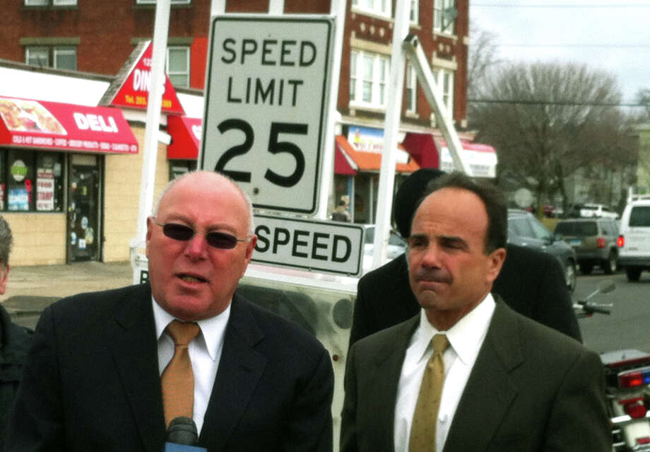 "Police Captain Armando ""A.J."" Perez and Mayor Joseph Ganim stand by a portable machine that registers vehicle speed on State Street Thursday. Police are trying to improve traffic safety following three pedestrian fatalities. Photo: Brian Lockhart / Hearst Connecticut Media / Connecticut Post"