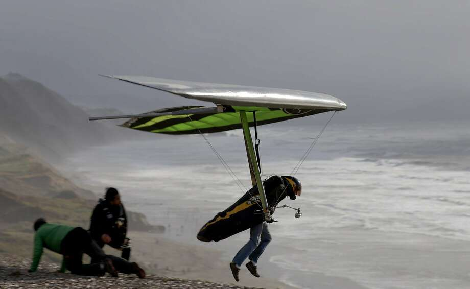 A hang glider takes off at Fort Funston in San Francisco, Calif. on January 23, 2016. Photo: Erin Brethauer, The Chronicle