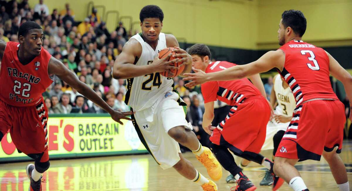Siena's Lavon Long, center, punches through a hole in the CBI final basketball game against Fresno State on Saturday, April 5, 2014, at the Alumni Recreation Center in Loudenville, N.Y. (Cindy Schultz / Times Union)