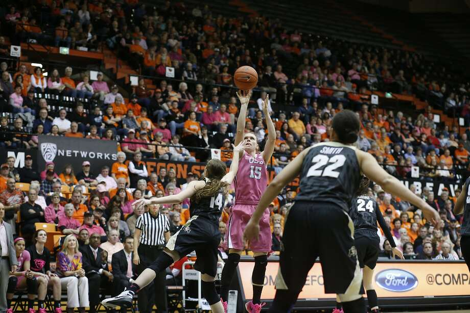 Oregon State's Jamie Weisner (15) and Colorado's Kennedy Leonard (14) and Haley Smith (22) in the second half of an NCAA college basketball game in Corvallis, Ore., on Friday, Feb. 12, 2016. (AP Photo/Timothy J. Gonzalez) Photo: Timothy J. Gonzalez, Associated Press