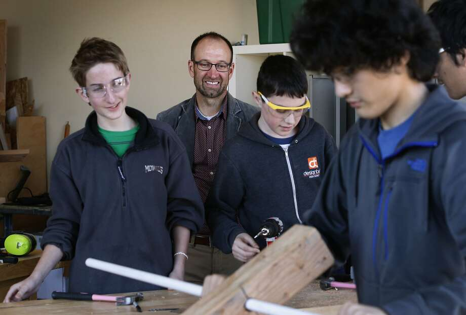 Kent Montgomery, Design Tech High's executive director, observes students working at the school's current home at a former adult-education center in Burlingame. Photo: Paul Chinn, The Chronicle