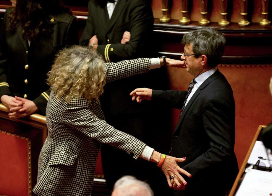 Senator Monica Cirinna', left, celebrates with Senator Sergio Lo Giudice following a confidence vote at the Italian Senate, in Rome, Thursday, Feb. 25, 2016. Italy's Senate voted Thursday to grant legal recognition to civil unions, as the last holdout in Western Europe took a compromise step to give some rights to gay couples after a bitter, years-long battle. (AP Photo/Alessandra Tarantino) Photo: Alessandra Tarantino, STF / AP