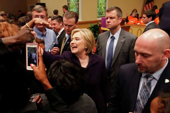 Democratic presidential candidate Hillary Clinton greets supporters after a campaign event at the Cumberland United Methodist Church in Florence, S.C., Thursday, Feb. 25, 2016. (AP Photo/Gerald Herbert)
