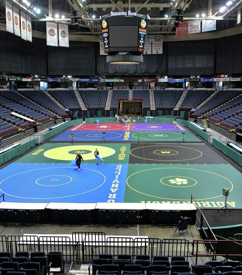 Crews ready the Times Union Center for the 2016 NYSPHSAA Wrestling Championships Thursday morning, Feb. 25, 2016, in Albany, N.Y. The event starts Friday morning and concludes Saturday evening. (John Carl D'Annibale / Times Union) Photo: John Carl D'Annibale / 10035578A
