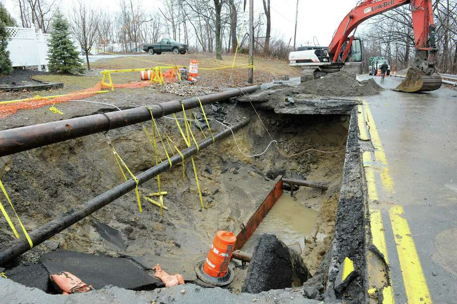 Site of a sinkhole on Campbell Ave. on Thursday, Feb. 25, 2016 in Troy, N.Y. Heavy rains prompted the city of Troy to declare an emergency and halt work at the Campbell Avenue site where the sinkhole opened up over the weekend. (Lori Van Buren / Times Union) Photo: Lori Van Buren / 10035591A