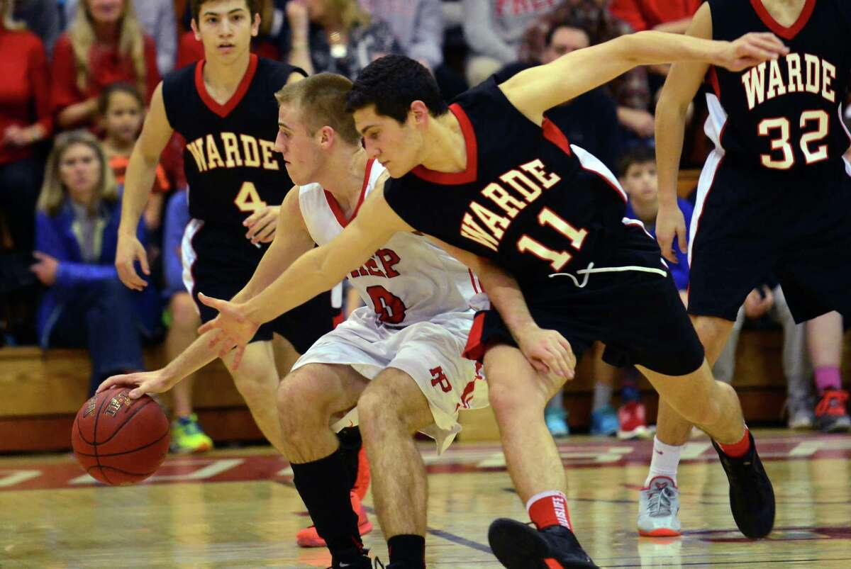 Fairfield Warde Giacomo Brancato reaches in to attempt to steal the ball away from Fairfielf Prep's Richard Kelly during Fairfield Prep Holiday Classic basketball action at Fairfield University's Alumni Hall in Fairfield, Conn. on Saturday Dec. 26, 2015.