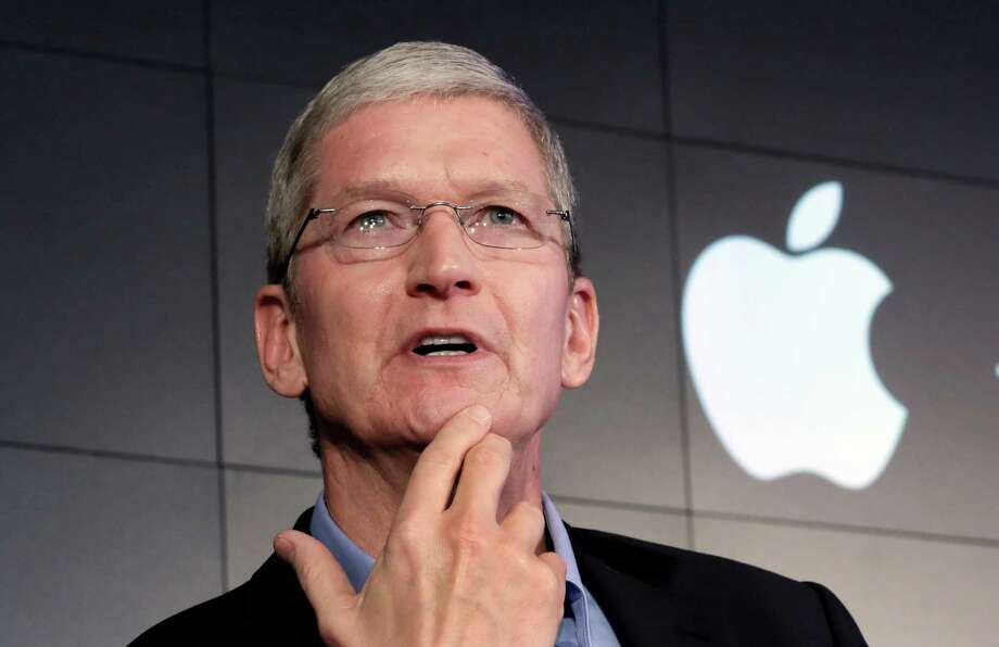 """FILE - In this April 30, 2015, file photo, Apple CEO Tim Cook responds to a question during a news conference in New York. Apple Inc. on Thursday asked a federal magistrate to reverse her order that the company help the FBI hack into a locked iPhone, accusing the federal government of seeking """"dangerous power"""" through the courts. (AP Photo/Richard Drew, File) ORG XMIT: WX102 Photo: Richard Drew / AP"""