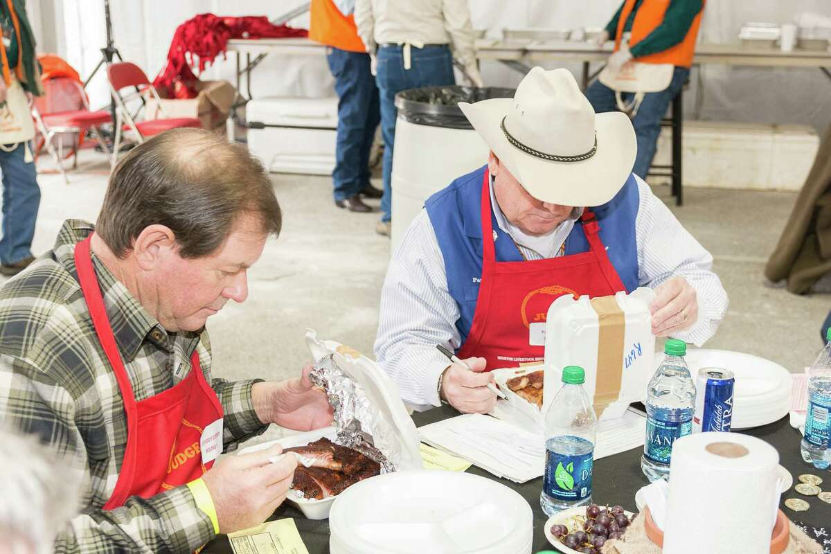 Cook-off judges evaluating barbecue samples at the World's Championship Bar-B-Que competition at the Houston Livestock Show and Rodeo in 2015.