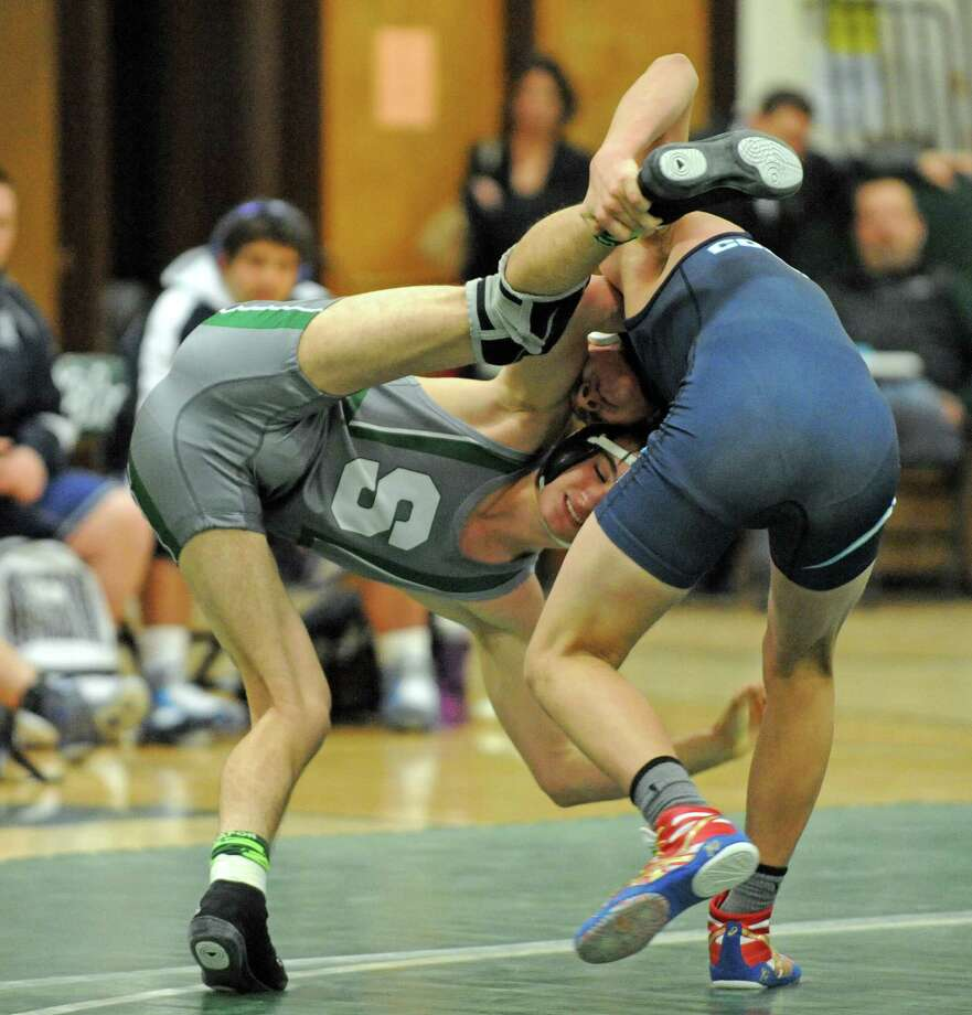 Shen's Kiernan Shanahan against Coulumbia's John Devine during their 126 lb. boy's high school wrestling match on Wednesday Jan. 20, 2016 in Clifton Park, N.Y. (Michael P. Farrell/Times Union) Photo: Michael P. Farrell / 10035039A
