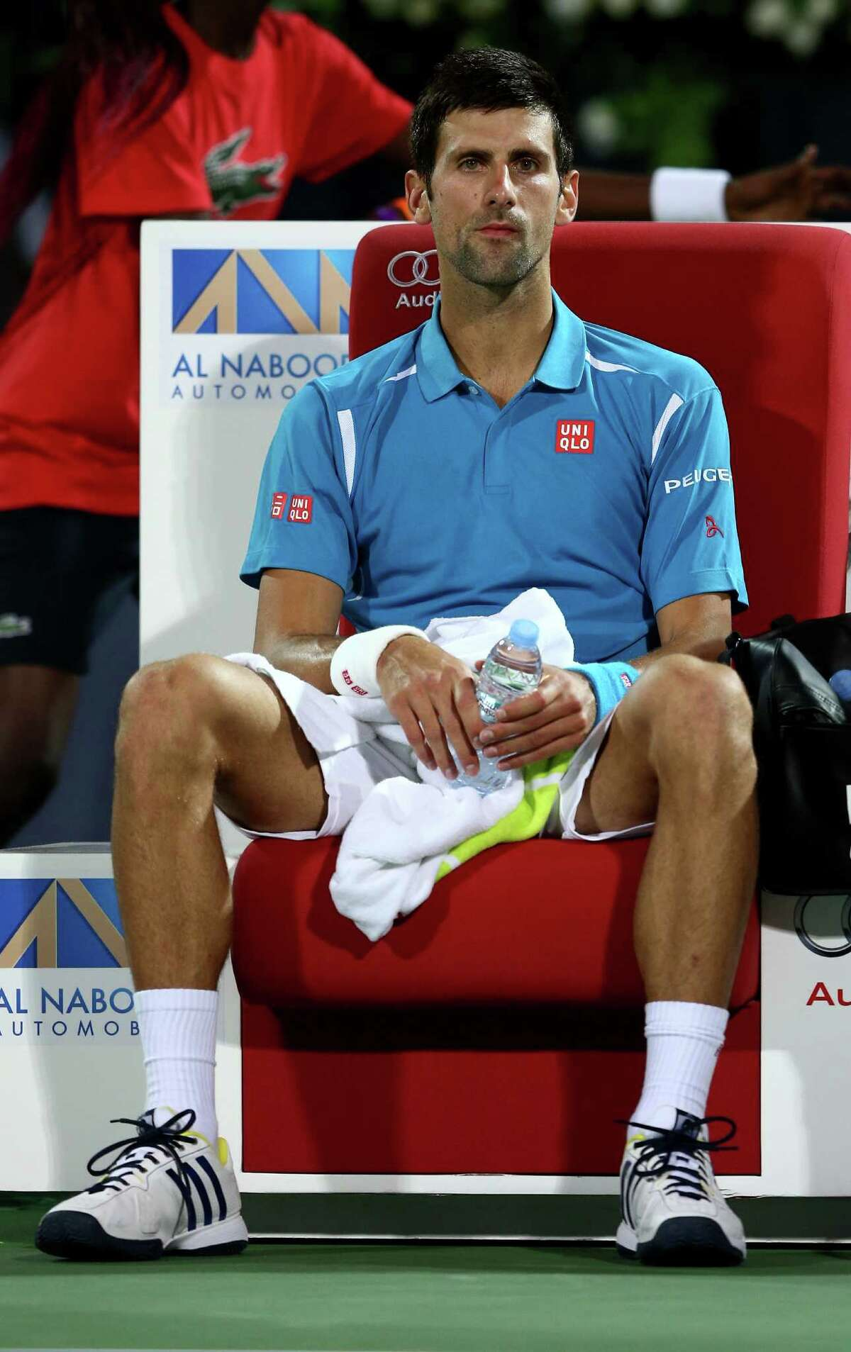 DUBAI, UNITED ARAB EMIRATES - FEBRUARY 25: Novak Djokovic of Serbia looks on in a break during his quarter final match against Feliciano Lopez of Spain on day six of the ATP Dubai Duty Free Tennis Championship at the Dubai Duty Free Stadium on February 25, 2016 in Dubai, United Arab Emirates. (Photo by Warren Little/Getty Images) ORG XMIT: 596688645