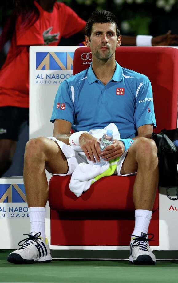 DUBAI, UNITED ARAB EMIRATES - FEBRUARY 25:  Novak Djokovic of Serbia looks on in a break during his quarter final match against Feliciano Lopez of Spain on day six of the ATP Dubai Duty Free Tennis Championship at the Dubai Duty Free Stadium on February 25, 2016 in Dubai, United Arab Emirates.  (Photo by Warren Little/Getty Images) ORG XMIT: 596688645 Photo: Warren Little / 2016 Getty Images