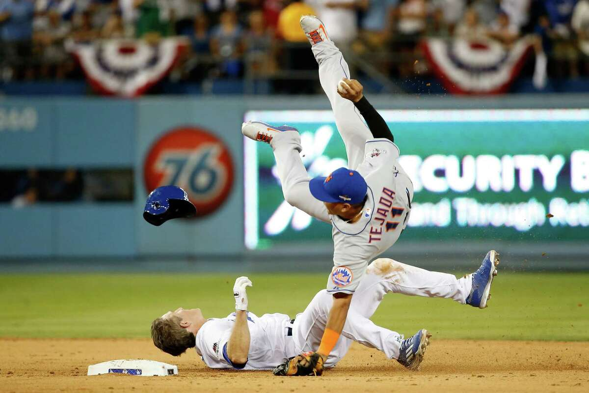 LOS ANGELES, CA - OCTOBER 10: Ruben Tejada #11 of the New York Mets is hit by a slide by Chase Utley #26 of the Los Angeles Dodgers in the seventh inning in an attempt to turn a double play in game two of the National League Division Series at Dodger Stadium on October 10, 2015 in Los Angeles, California. (Photo by Sean M. Haffey/Getty Images) ***BESTPIX*** ORG XMIT: 583924755