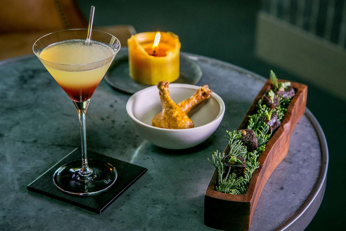 """The """"Spicebush"""" cocktail with the dried Beef Juniper and the Poussin Leg snacks in the lounge at the Meadowood Restaurant in St. Helena, Calif. is seen on February, 25th, 2016."""