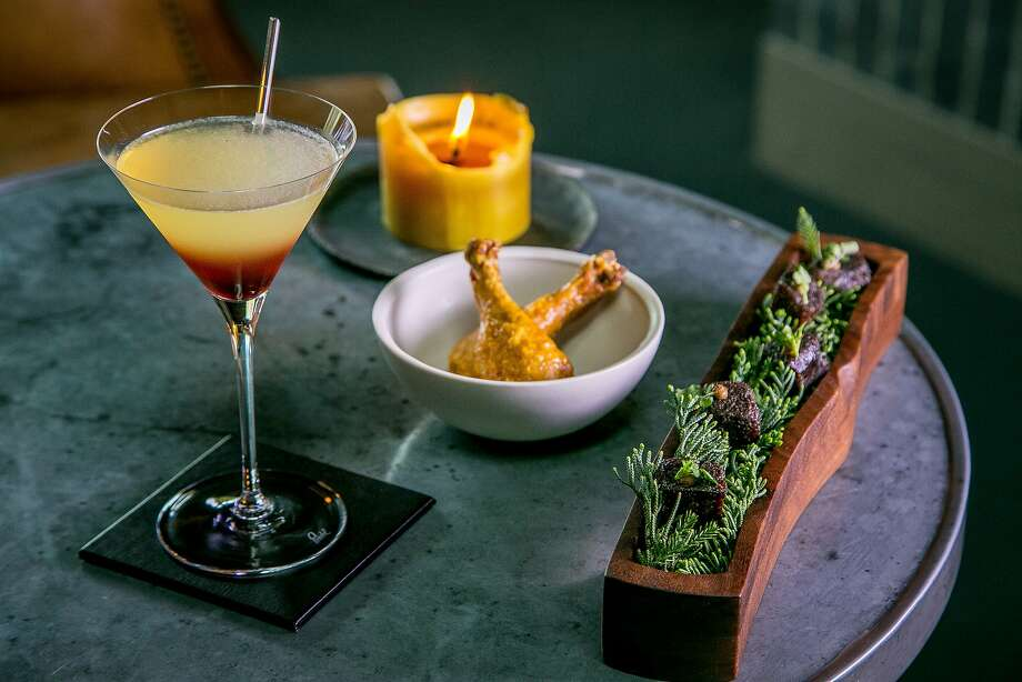 "The ""Spicebush"" cocktail with the dried Beef Juniper and the Poussin Leg snacks in the lounge at the Meadowood Restaurant in St. Helena, Calif. is seen on February, 25th, 2016. Photo: John Storey, Special To The Chronicle"