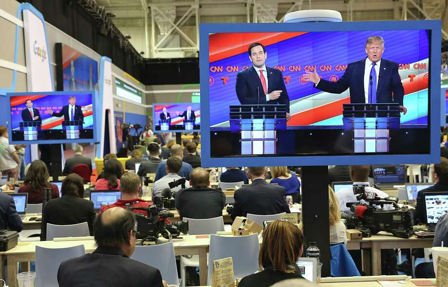 US Republican Presidential Candidates Marco Rubio and  Donald Trump are seen on television in the CNN filing room during the Republican Presidential Debate at the University of Houston in Houston, Texas on February 25, 2016. / AFP / Thomas B. SheaTHOMAS B. SHEA/AFP/Getty Images Photo: THOMAS B. SHEA, AFP / Getty Images / AFP or licensors