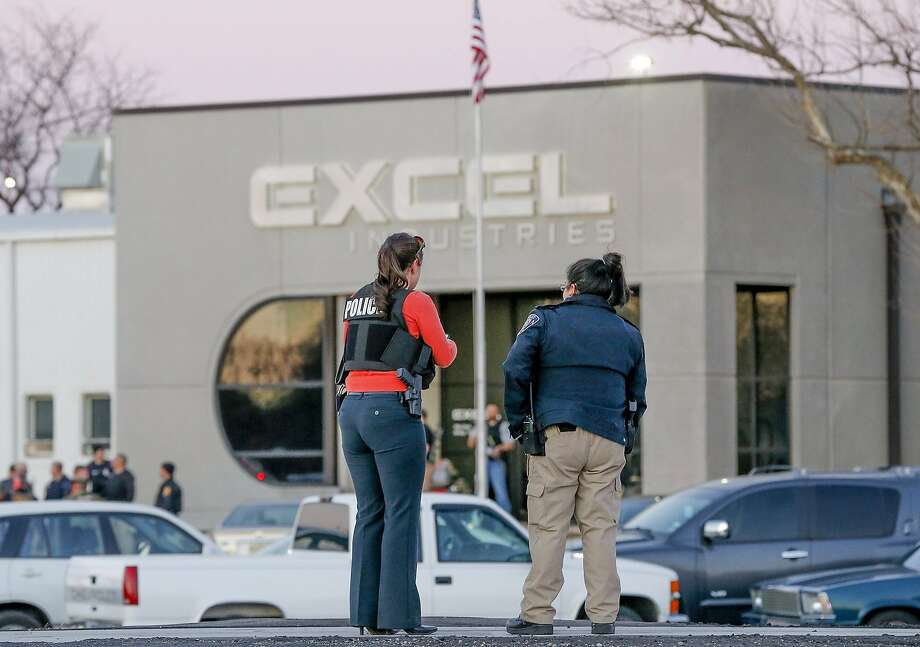 Police guard the front door of Excel Industries in Hesston, Kan., Thursday, Feb. 25, 2016, where a gunman killed an undetermined number of people and injured many more. (Fernando Salazar/The Wichita Eagle via AP) Photo: Fernando Salazar, Associated Press