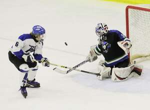 Saratoga's  Colin Paton (6) is deflected by Tri-Falls' goaltender Owen Johnston (35) in the first period of a section II high school hockey championship game Thursday, Feb. 25, 2016, in Schenectady, N.Y., (Hans Pennink / Special to the Times Union) ORG XMIT: HP101
