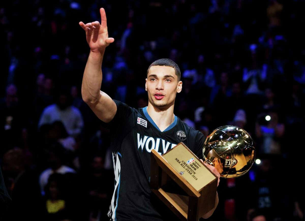 Minnesota Timberwolves' Zach LaVine holds the trophy after winning the slam dunk contest during the NBA All-Star weekend in Toronto, Saturday, Feb. 13, 2016. (Mark Blinch/The Canadian Press via AP) ORG XMIT: NSD168