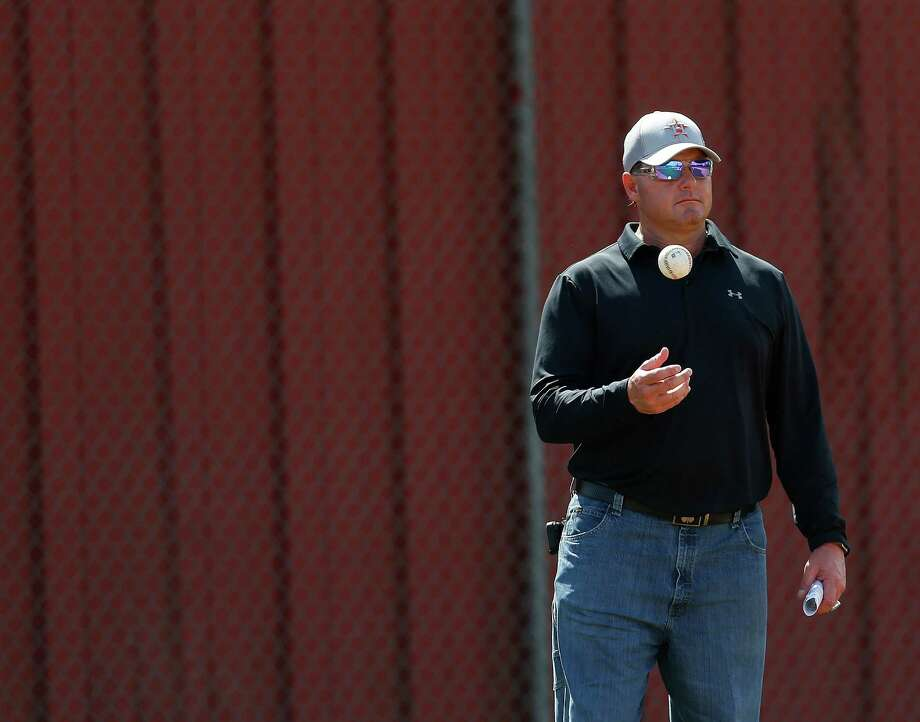 On his final day at camp Thursday, Roger Clemens shared the secrets of the splitter with some prospects. Photo: Karen Warren, Staff / © 2015  Houston Chronicle