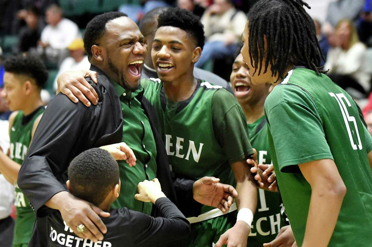 Green Tech coach Jamil Hood Sr., left, celebrates with his team when they win 57-37 over Guilderland in their Class AA basketball semifinal on Thursday, Feb. 25, 2016, at Glens Falls Civic Center in Glens Falls, N.Y. (Cindy Schultz / Times Union)