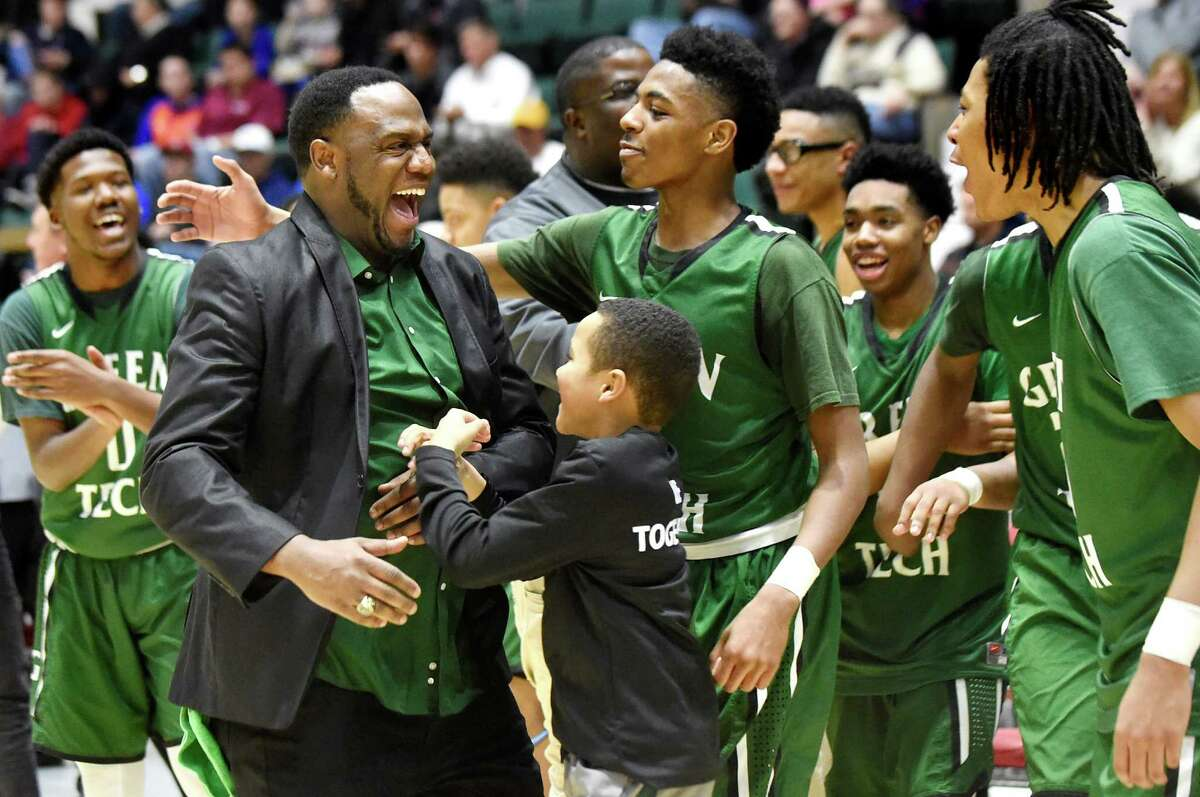 Green Tech coach Jamil Hood Sr., second from left, celebrates with his team when they win 57-37 over Guilderland in their Class AA basketball semifinal on Thursday, Feb. 25, 2016, at Glens Falls Civic Center in Glens Falls, N.Y. (Cindy Schultz / Times Union)