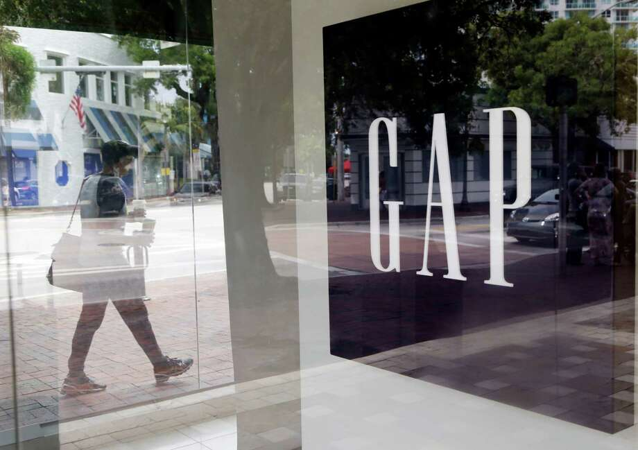 San Francisco-based Gap reported on Thursday a  33 percent drop in its fourth-quarter profit. Photo: Lynne Sladky, STF / AP