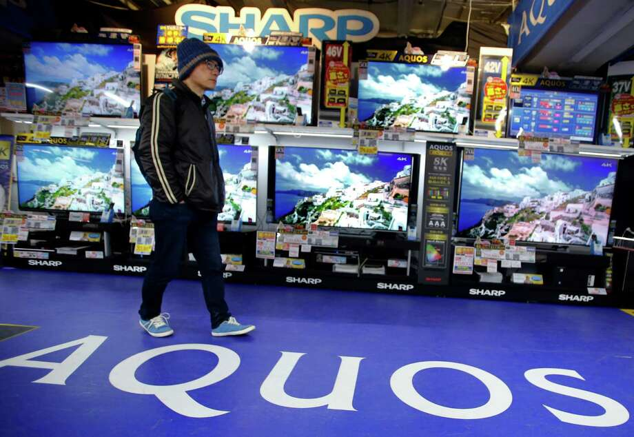 Sharp's Aquos flat-panel TVs are displayed at an electronics store in Tokyo. Foxconn of Taiwan unexpectedly balked just before a deal was to be sealed Thursday for it to buy Sharp, a troubled Japanese company. Photo: Shizuo Kambayashi, STF / AP