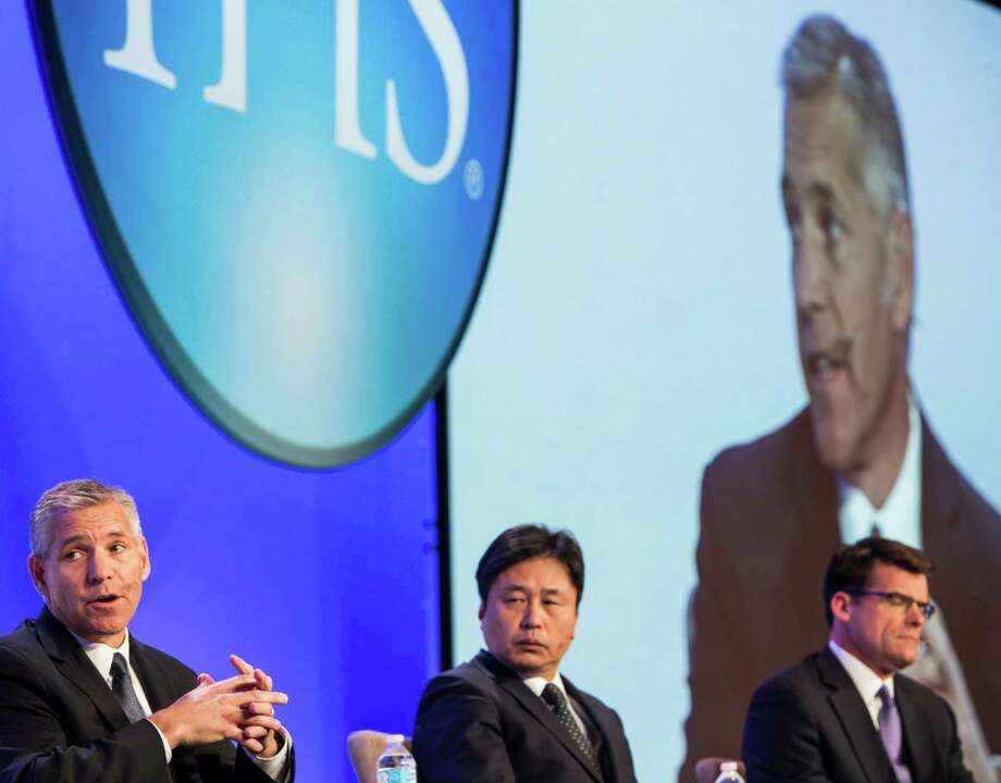 Russ Girling, president and CEO, TransCanada, left, Hirohide Hiral, director general, Agency for Natural Resources & Energy, METI, Japan, participate in the Infrastructure & Technology Plenary: The Shape of Things to Come at IHS Energy CERAWeek at the Hilton Americas on Thursday, Feb. 25, 2016, in Houston. ( Brett Coomer / Houston Chronicle ) Photo: Brett Coomer, Staff / © 2016 Houston Chronicle