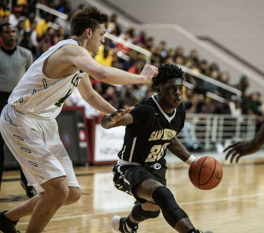 Ja'Qualin Greene Duplechain of Sam Houston dribbles to the basket during a game Thursday February 25, 2016. Sam Houston played Cy Falls in a boys basketball playoff game at the Campbell Center. Photo: Michael Starghill, Jr. / © 2016 Michael Starghill, Jr.