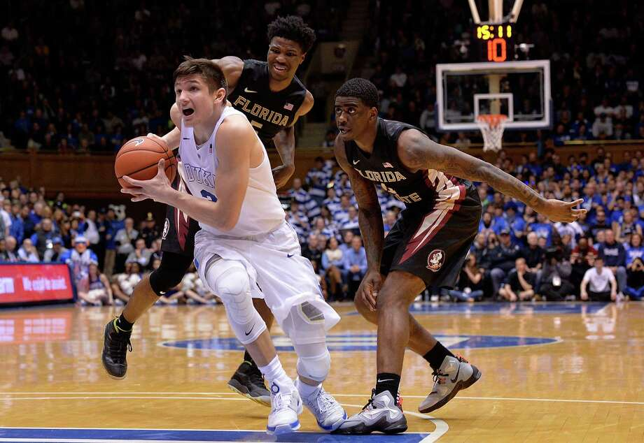 DURHAM, NC - FEBRUARY 25:  Grayson Allen #3 of the Duke Blue Devils drives past Malik Beasley #5 and Dwayne Bacon #4 of the Florida State Seminoles during their game at Cameron Indoor Stadium on February 25, 2016 in Durham, North Carolina. Duke won 80-65.  (Photo by Grant Halverson/Getty Images) ORG XMIT: 587451775 Photo: Grant Halverson / 2016 Getty Images