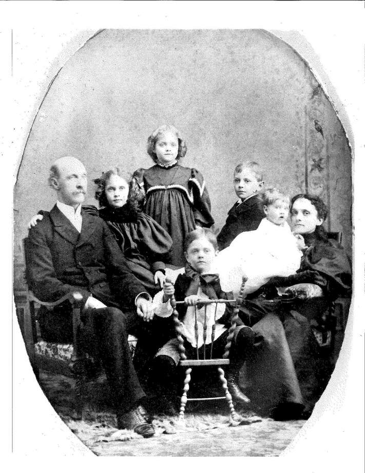 """A photo of Walter Barrows, left, the minister of the Second Congregational Church from 1897 to 1899, with his five children, Loring, Paul, Dorothea, Winifred and Priscilla, all Greenwich Academy graduates, can be seen at """"The Strength of All Thy Past,"""" exhibition.  exploring Greenwich Academy's 188-year history through materials that are part of Greenwich Academy's archives at the school in Greenwich, Conn., Thursday, Feb. 18, 2016. According to Kristen Erickson, a teacher and dean at the school, the exhibtion will be on display at the Luchsinger Gallery at the school until May 3rd. Photo: Bob Luckey Jr. / Hearst Connecticut Media / Greenwich Time"""